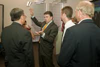 Governor Rick Perry, center, talks with attendees after presenting Emerging Technology Fund grants at the Houston Technology Center, Sept. 29, 2010, in Houston. (Dave Einsel/Special Contributor)
