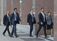 Facebook CEO Mark Zuckerberg arrives with his entourage at the Earl Cabell Courthouse in Dallas to testify in an intellectual property lawsuit on Tuesday, January 17, 2017. (Louis DeLuca/The Dallas Morning News)(Louis DeLuca/Staff Photographer)