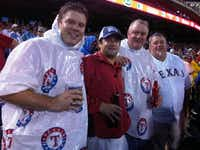<p>Joshua Harbuck (left) at a Texas Rangers game with his father, Hal Jay (second from right). (Facebook)</p>