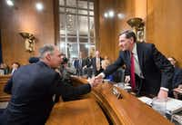 EPA administrator-designate Scott Pruitt was welcomed to Capitol Hill on Wednesday by fellow Republican and Senate Environment and Public Works Committee Chairman John Barrasso of Wyoming. (J. Scott Applewhite/The Associated Press)