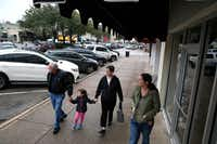 Dave Krainbucher (from left) walks with his granddaughter Charlotte Camp, 4, with his wife Kathy Krainbucher and daughter Joelle Camp after eating at Kuby's at Snider Plaza in Dallas on January 18, 2017.)(Nathan Hunsinger/ Staff Photographer)