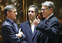 Retired U.S. Army Lieutenant General Michael T. Flynn, left, chats with former Texas Gov. Rick Perry, right, and Trump attorney Michael D. Cohen, center, in the lobby at Trump Tower, Monday, Dec. 12, 2016, in New York. (Kathy Willens/AP)