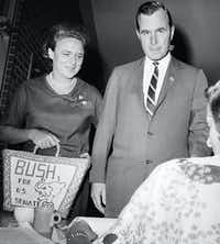 George H. W. Bush and his wife Barbara cast their votes in Houston for the 1964 Texas Senate primary race, as Bush sought to win the primary over opponent Jack Cox before facing Democratic Sen. Ralph Yarborough in the November general election.(Ed Kolenovsky/AP)