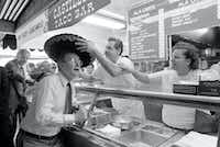 Vice President George H.W. Bush checked out a sombrero while campaigning at Farmers Market in Los Angeles in March 1988.(Marsha Traeger/Los Angeles Times)