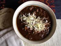 Garnish the chili with chopped onions and grated cheese. Cornbread or handmade tortillas go great, too.(Leslie Brenner/Staff)