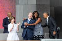 (L-R) Former US First Lady Laura Bush, former US President George W. Bush, First Lady Michelle Obama, and President Barack Obama attend the opening ceremony for the Smithsonian National Museum of African American History and Culture on September 24, 2016 in Washington, D.C. AFP PHOTO / ZACH GIBSON(AFP/Getty Images)