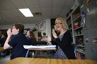 LuAnn Dolly, American history teacher, claps after an eighth grade student recites the Star Spangled Banner during class at The June Shelton School in Dallas on Jan. 17, 2017. Dolly was selected among all teachers at The Shelton School to go on her dream trip to the Presidential Inauguration and to see the musical Hamilton on Broadway. (Rose Baca/The Dallas Morning News)