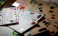 Cards that Angela Joy Bailey wrote sit on the table at her grandparents' home. (Jae S. Lee/ The Dallas Morning News)