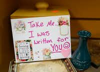 A card that Angela Joy Bailey wrote sits on shelves at The Coat of Many Colors store in Bedford.(Jae S. Lee/ The Dallas Morning News)