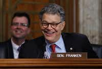 Sen. Al Franken, D-Minn., laughs as he asks questions of and jokes with Energy Secretary-designate, former Texas Gov. Rick Perry on Capitol Hill in Washington, Thursday, Jan. 19, 2017, at Perry's confirmation hearing before the committee. (AP Photo/Carolyn Kaster)