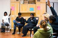 """Program manager Monica McGee, center, leads a group session at the Austin Street Center's women's day resource program called """"The Sisterhood."""" (Ashley Landis/The Dallas Morning News)(Staff Photographer)"""