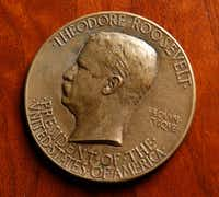 An inaugural medal of Theodore Roosevelt from 1905 in Hervey Priddy's collection at Degolyer Library. This item is not on display at the Bush Library. (Nathan Hunsinger/Staff Photographer)