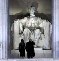 President-elect Donald Trump salutes Abraham Lincoln before he and his wife, Melania, descend the steps of the Lincoln Memorial to a welcome concert on the day before his inauguration in Washington, Jan. 19, 2017.&nbsp;(Doug Mills/New York Times<div><br></div>)