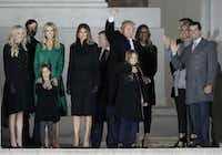 """President-elect Donald Trump and his wife Melania Trump stand with family at the conclusion of a pre-Inaugural """"Make America Great Again! Welcome Celebration"""" at the Lincoln Memorial in Washington, Thursday, Jan. 19, 2017.(David J. Phillip/AP)"""