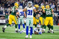 Dallas Cowboys free safety Byron Jones (31) and Dallas Cowboys cornerback Anthony Brown (30) react as Green Bay Packers players mob kicker Mason Crosby (2) kicked a game-winning 51-yard field goal at AT&T Stadium in Arlington. (Smiley N. Pool/The Dallas Morning News)