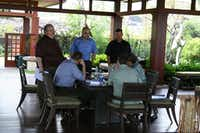 Tettamant (standing at left) at one of the fund's luxury homes in Hawaii in 2008. He and other representatives of the pension fund spent close to $1 million between 2009 and 2012 on travel that included due diligence inspections of fund properties.