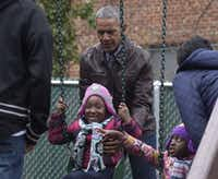 "President Barack Obama pushes kids on the swings as they visit ""Malia and Sasha's Castle,"" the playground that the Obamas donated to the Jobs Have Priority Naylor Road Family Shelter in Washington, Monday, Jan. 16, 2017. (AP Photo/Susan Walsh)(Susan Walsh/AP)"