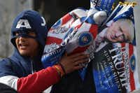 A vendor in a Captain America hoodie sells souvenir flags in a Washington, DC, January 19, 2017, one day ahead of the inauguration of the US President-elect Donald Trump.  / AFP PHOTO / PAUL J. RICHARDSPAUL J. RICHARDS/AFP/Getty Images(PAUL J. RICHARDS/AFP/Getty Images)