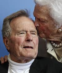 In a June 12, 2012 file photo, former President George H.W. Bush, and his wife former first lady Barbara Bush, arrive for the premiere of HBO's new documentary on his life near the family compound in Kennebunkport, Maine. ((Charles Krupa/The Associated Press))