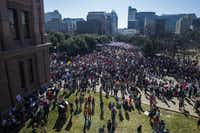 Thousands of demonstrators gather at the Texas state Capitol during the Austin Women's March on Saturday. The event was held in solidarity with the Women's March on Washington. ((Ashley Landis/Staff Photographer))