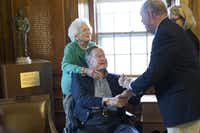 Former President George H.W. Bush and wife Barbara Bush remain hospitalized.  (2015 File Photo/The Associated Press)