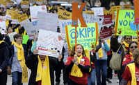 Students, teachers and supporters march on the grounds of the Texas Capitol, Friday, Jan. 30, 2015, in Austin, Texas. (AP Photo/Eric Gay) (AP)