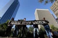 Protesters hold a sign calling for the arrest of Dallas based Energy Transfer Partners CEO Kelcy Warren during a protest outside the federal building housing the Army Corps of Engineers offices in Dallas in November 2016. People across the U.S. gather to show solidarity with opponents of the Dakota Access oil pipeline being built by Energy Transfer Partners. (AP Photo/LM Otero)