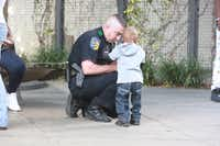 DART Officer Elmar Cannon interacts with a boy during a patrol in 2015 near the West End district in downtown Dallas.((Lupe Hernandez Jr./DART))