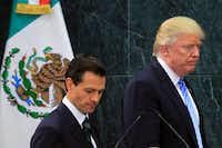 President Trump, right, with Mexican President Enrique Pena Nieto after their Aug. 31, 2016, meeting in Mexico City. Trump's executive order to immediately start construction of a border wall has widened his rift with Mexico. (Str/Xinhua/Sipa USA/TNS)(TNS)