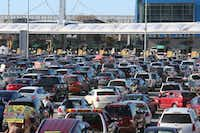 Motorists wait in line at the U.S.-Mexico border in Tijuana, Mexico. (Sandy Huffaker/Getty Images)