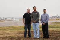 <p>Air traffic controller Marc Gough (left) alerted pilot Daniel Luna (center) and FAA inspectorCristóbalDiaz that smoke was spilling from the front of their plane during a flight. They're pictured at the north end of Addison Airport's single runway. (Lawrence Jenkins/Special Contributor)</p>