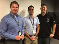 <p>Air traffic controllers Josh Kovar (left) and Marc Gough (right) helped resolve the crisis that developed for a Cessna just after it left the runway. FAA inspector Cristóbal Diaz (center) was aboard the flight, overseeing an instructor certification check ride by a student pilot. The photo was taken during a later event at Addison Airport to recognize the controllers for their quick thinking in the moment of danger. (FAA)</p>