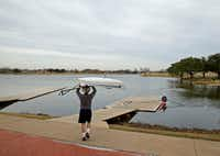 Dallas Rowing Club member Patrick Genevein takes his boat out for a workout at Bachman Lake in Dallas on January 24. ((Nathan Hunsinger/Staff photographer))