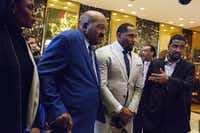 Omarosa Manigault and former professional football players Jim Brown, Ray Lewis, and Pastor Darrell Scott speak to members of the media in the lobby of Trump Tower in December. (John Taggart/Bloomberg)