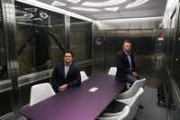 Purple Land Management owners Bryan Cortney and Jesse Hejny show off their funky elevator conference room.  The 1919 freight elevator used to transport autos from floor to floor of Fort Worth's first parking garage.<div><div>(Lawrence Jenkins/Special Contributor)</div></div>