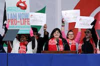 Abby Johnson (center) addressed a rally on the National Mall before the start of the 44th annual March for Life on Friday in Washington. (Chip Somodevilla/Getty Images)
