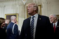U.S. President Donald Trump at first mocked protesters who gathered for large demonstrations across the U.S. and the world on Jan. 21 to signal discontent with his leadership but later offered a more conciliatory tone, saying he recognized such marches as a hallmark of our democracy.((Andrew Harrer/Bloomberg))