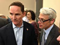 Dallas County Judge Clay Jenkins, at left, and Rabbi David Stern of Temple Emanu-El visited with attorneys and families of those being detained because of the president's executive order signed Friday.((Robert Wilonsky/Staff writer))