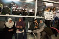 :Protesters gather to denounce President Donald Trump's executive order that bans certain immigration, at Dallas-Fort Worth International Airport on January 28, 2017 in Dallas, Texas. (G. Morty Ortega/Getty Images)