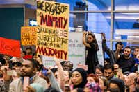 Protesters made their voices heard over the weekend at DFW International Airport after several travelers were detained. (Smiley N. Pool/Staff Photographer)