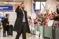 Imam Omar Suleiman celebrated Sunday with protesters at DFW International Airport who gathered in opposition to President Donald Trump's executive order. (Smiley N. Pool/Staff Photographer)
