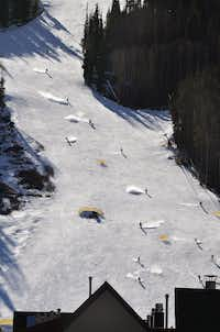 Skiers and riders stir up the snow on a sunlit River Run at the ski resort in  Keystone, Colo. (2012 File Photo/Summit Daily News)