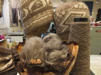 Raw fur from musk ox and the yarn it produces are placed beside the headgear it produces. The woven products are for sale at Oomingmak, an Anchorage store that helps sustain families in Alaska's remote native villages.Jay Jones