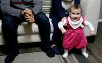 Sidra Jawish, 9 months old, plays while her parents, Syrians Moustafa Jawish and Reem Khero, were interviewed in their Dallas home on Sunday. (Andy Jacobsohn/Staff Photographer)