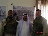 Vaught and one of his staff sergeants met with a tribal leader in Fallujah in 2003.