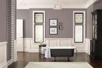 A deep, balanced neutral that combines warm and cool tones, Poised Taupe by Sherwin-Williams represents a transition away from monochrome gray tones. The color pairs well with both black and white. ((Sherwin-Williams))