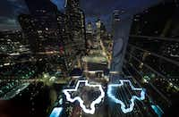 A pool in the shape of Texas is illuminated at the Marriott Marquis Houston, the NFL headquarters for Super Bowl LI. (AP Photo/David J. Phillip)