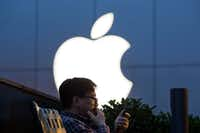"<p><span style=""font-size: 1em; background-color: transparent;"">Propelled by the iPhone, Apple Inc.'s revenue edged up 3 percent to $78.4 billion in the quarter. </span><span style=""font-size: 1em; background-color: transparent;"">(AP Photo/Ng Han Guan, File)</span></p>"