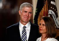 Judge Neil Gorsuch stands with his wife Louise as President Donald Trump speaks in the East Room of the White House in Washington, Tuesday, Jan. 31, 2017, to announce Gorsuch as his nominee for the Supreme Court.(AP Photo/Carolyn Kaster)(AP)