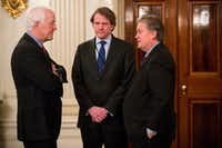 Sen. John Cornyn speaks with White House counsel Don McGahn (center) and senior adviser Stephen Bannon (right) before a meeting with President Donald Trump on Jan. 23. No president in modern times, if ever, has taken office with such a flurry of initiatives and proclamations. (Doug Mills/The New York Times